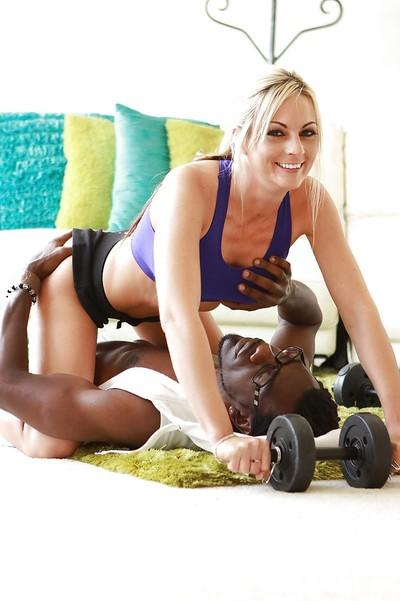 Lewd sporty cougar seduces her black coach with her tempting curves