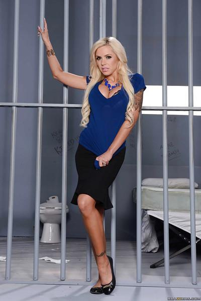 Big tits milf Nina Elle is undressing her blue skirt in a prison shell