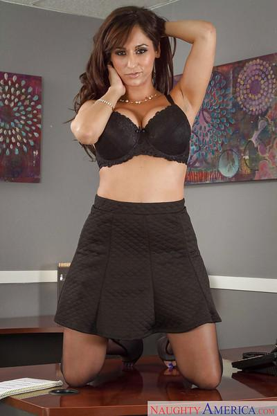 Milf brunette Reena Sky is undressing very sexy right in the office