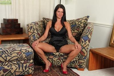 Sweet brunette model Veronica undressing her new black dress