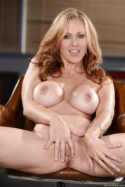 Babe with curly hair Julia Ann reveals her moist pussy and nice coupler