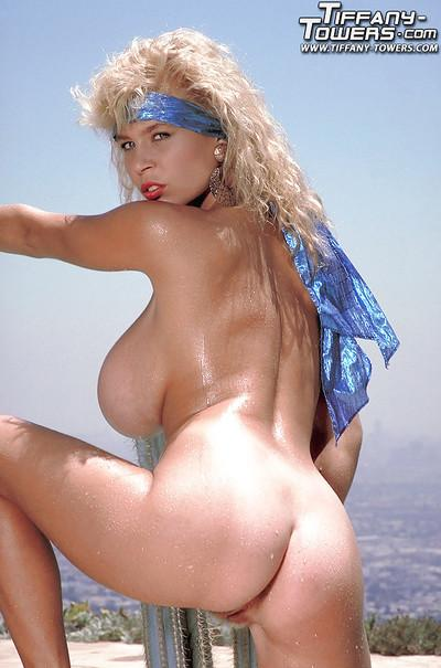 Blonde solo girl Tiffany Towers unveils huge MILF pornstar breasts outdoors