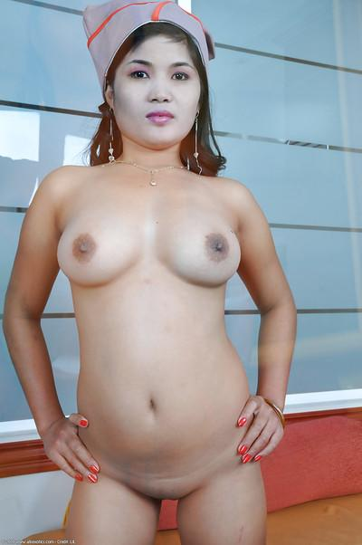 Exotic Oriental babe Jenny posing solo in military uniform
