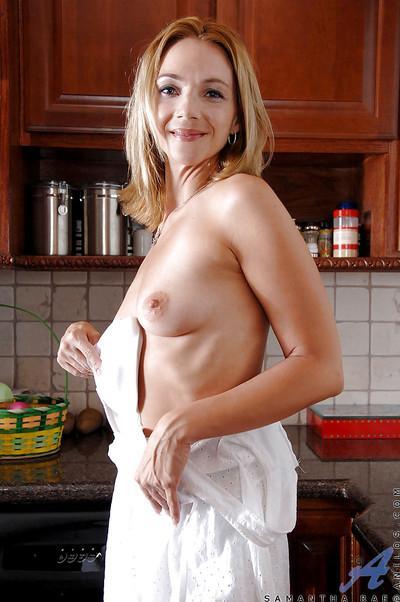 Adorable MILF blonde Samantha Rae revealing big ass from sheer panties
