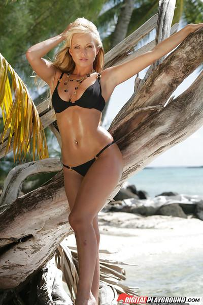 Slender tanned blonde is showing off herself naked on the beach
