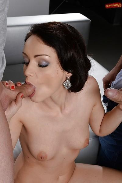 Gentle girl Sophie Lynx stands on her knees and swallows huge dongs
