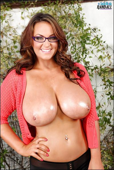 Cute pornstar Sarah showing her oiled up huge tits with hard nipples