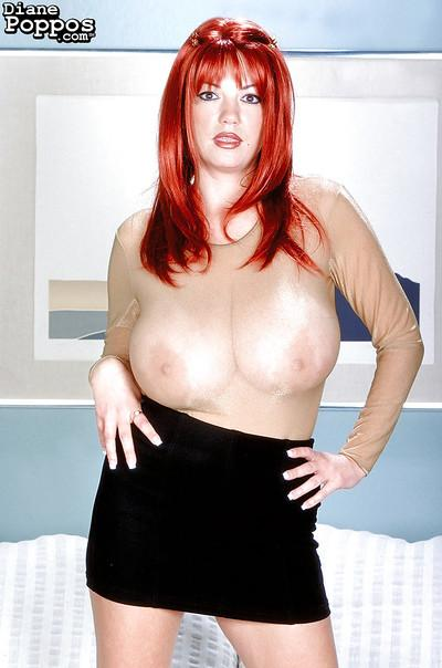 Redhead Greek babe Diane Poppos exposing massive MILF tits and hairy cunt
