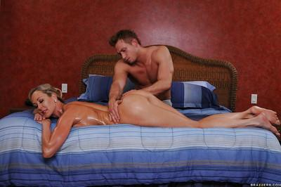 Sexy MILF Brandi Love gives a footjob and gets fucked after massage