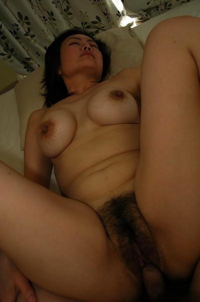Busty asian MILF Kaoru Mitamura enjoys pussy toying and fucking action