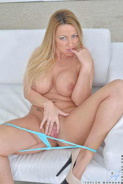Taylor Morgan is teasing her big tits and huge ass in sweet blue underwear