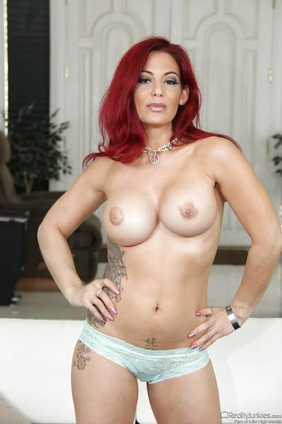 Redhead babe Ryder Skye exposing big juggs and shaved MILF pussy