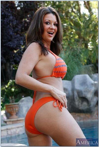 Bikini milf Raquel Devine in a classy outdoor masturbation shoot