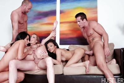 MILF pornstars ride on top of large cocks before taking groupsex cumshot