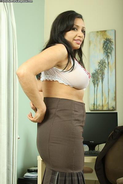 Naughty latina MILF revealing her rubenesque curves in her office