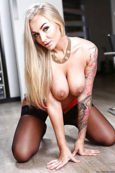 Hot blond MILF Kayla Green modeling fully clothed in lingerie and stockings