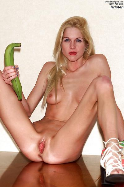 Milf Kristen spread her legs and penetrates shaved puss with dildo