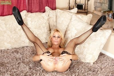 Juggy MILF in fishnet stockings undressing and teasing her juicy gash