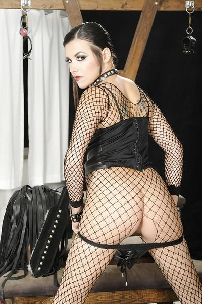 Kinky MILF babe Danica Dillon feels her cunt in a fetish outfit