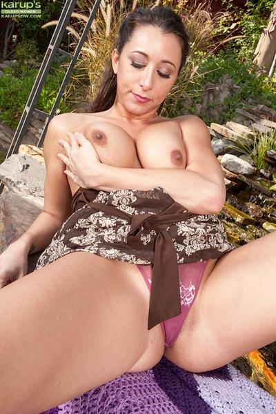 Close up scene of the outstanding milf Kaylynn in her yard