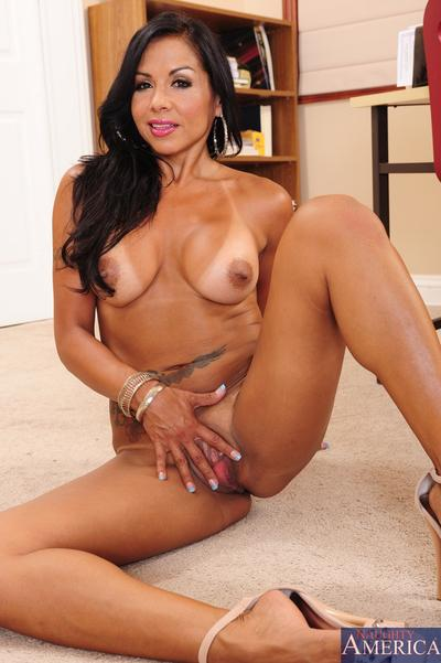 Raven-haired MILF Viana Milian undressing and spreading her legs