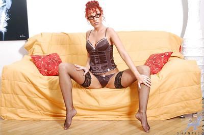 Hot redhead MILF babe masturbates in sexy stockings.