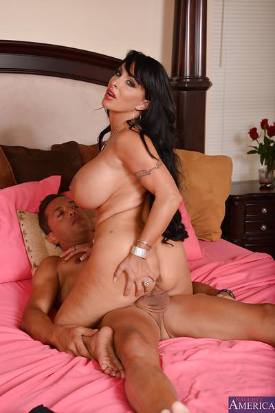 Lewd cougar Holly Halston gets fucked and jizzed over her massive jugs