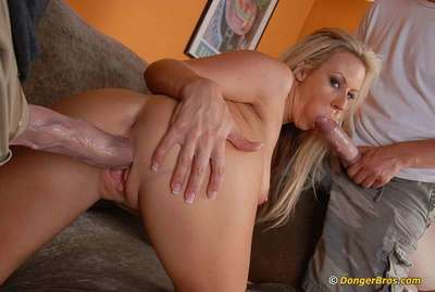 Busty MILF has some dirty fun with two huge dicks and gets jizzed all over