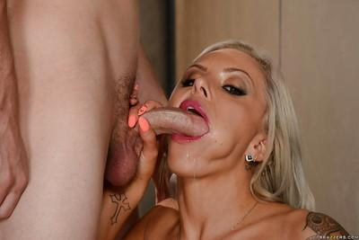Buxom blond Nina Elle has nipples and cunt licked by younger man