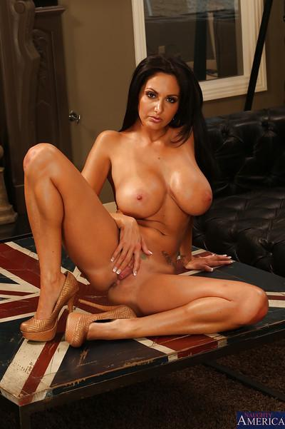 Stunning brunette MILF with big tits and shaved cunt posing nude