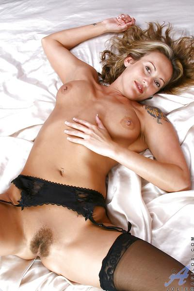 Gorgeous MILF blonde flaunting in black gartered stockings with her cunt exposed