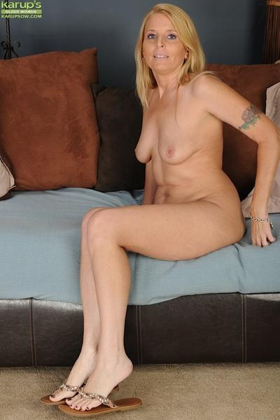 Milf blonde with big tits Sky Martin demonstrates her tight pussy