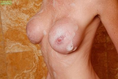 Big boobed MILF Jessica Rayne covered in soapy bubbles after bath time