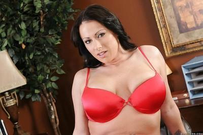 Flirtatious MILF secretary Moxxie Maddron stripping nude in the office
