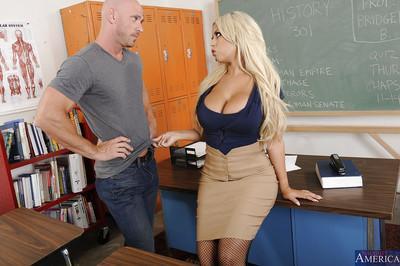 Lewd teacher in stockings fucks her student and milks his boner on her jugs