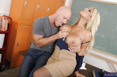Lewd teacher in stockings fucks her student and milks his boner on her jugs
