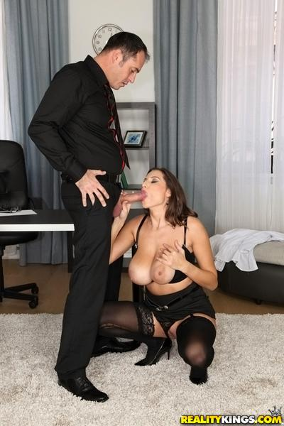 Big breasted mom Sensual Jane gives a close up blowjob at the office