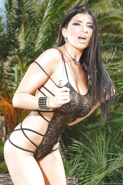 Outstanding big tit MILF Romi Rain showing off her boobs outdoors
