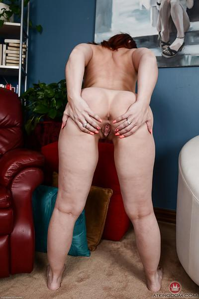 Chunky redhead Crystal Rayne displaying big butt in a thong