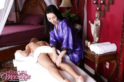 Gorgeous lesbian milf Rayveness doing massage to Victoria Rae