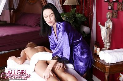 Gorgeous lesbian milf Rayveness doing massage to Victoria Rae
