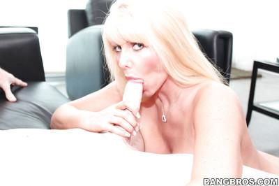 Horny MILF with big tits Karen Fisher seduces and fucks a younger guy