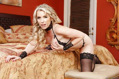Blonde MILF Courtney Cruz posing in black stockings and panties