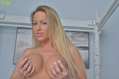 Blonde mom Taylor Morgan unleashing big boobs in lingerie and high heels
