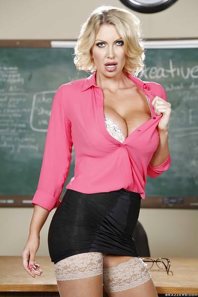Slutty milf teacher Leigh Darby shows her cute big boobies in the room