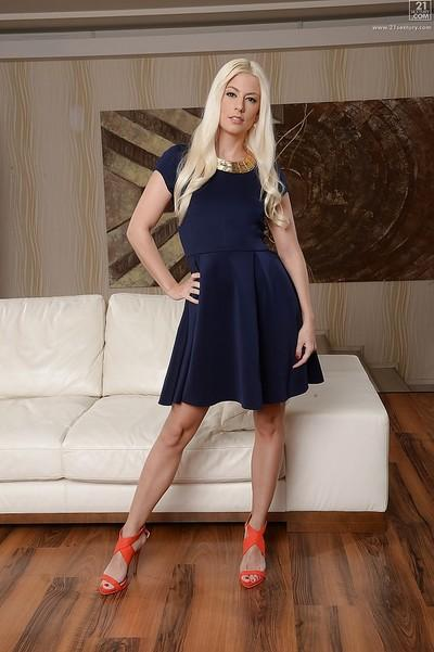 Sultry blonde babe Jessie Volt posing fully clothed in dress and high heels