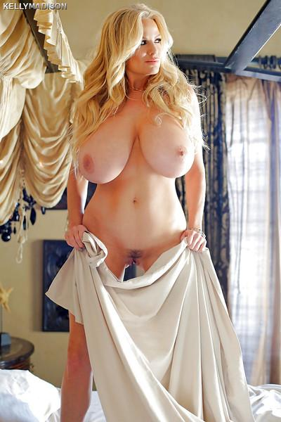 Buxom blonde boob model Kelly Madison and her big hangers masturbating