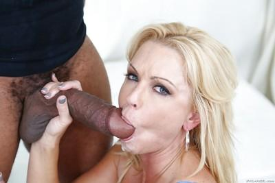 Over 30 MILF Naughty Alysha giving a huge black cock a blowjob on knees