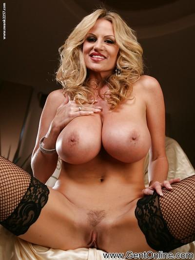 MILF babe in sexy stockings Kelly Madison teases her wet pussy