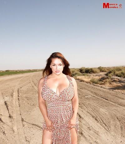 Humble ginger-head milf Monica Mendez rubs down her beautiful breasts